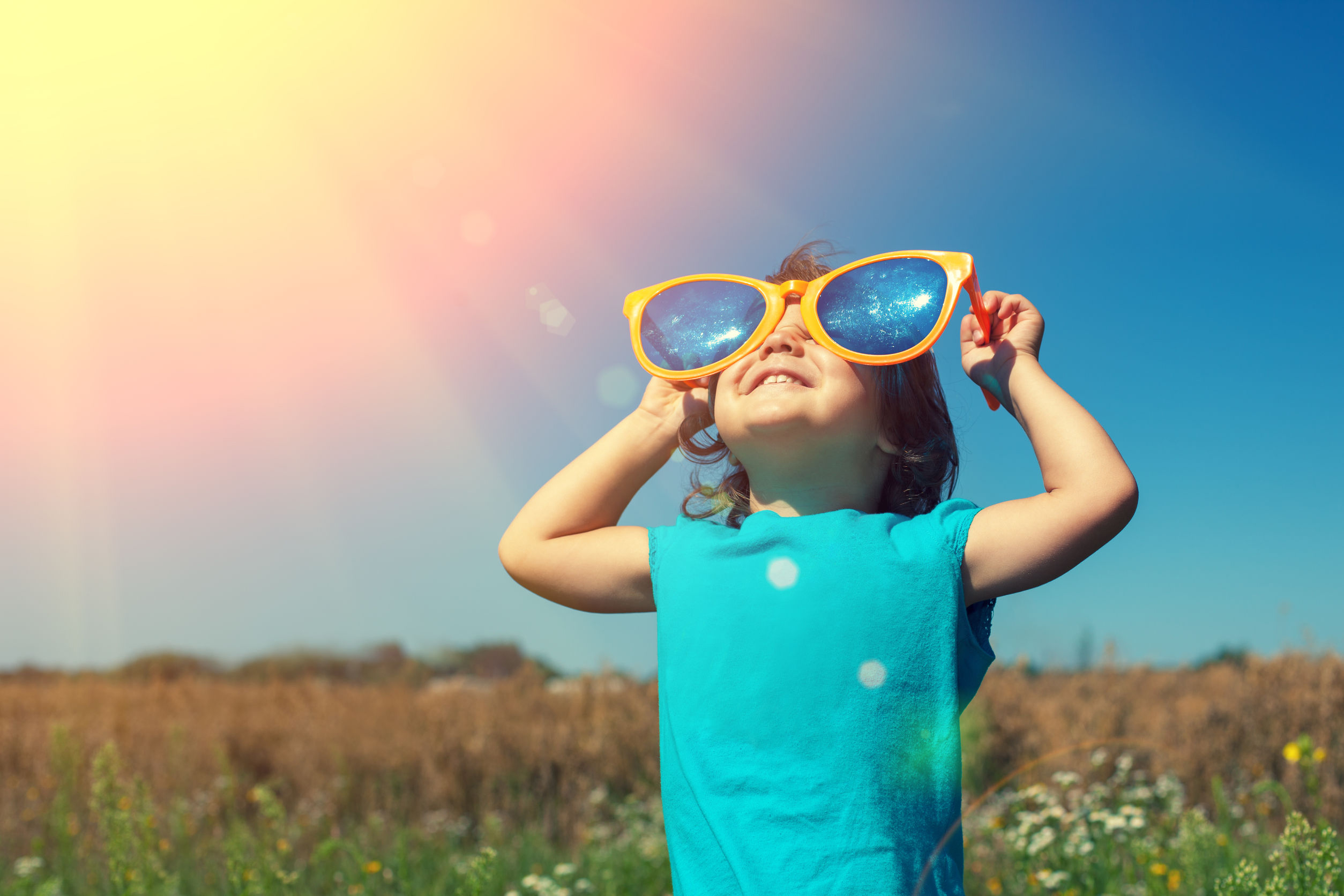 40361353 - little girl with big sunglasses enjoys sun